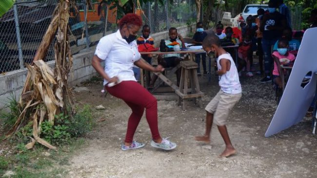 Jody-Ann Fearon Digicel Public Relations Executive carries out activity with students at the Foster's Online School