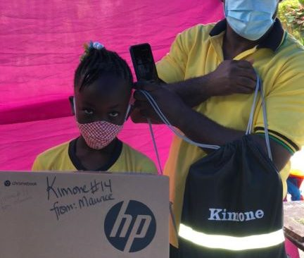 Kimone receives her gift of laptop and bag