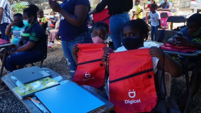 Students show off their bags from Digicel